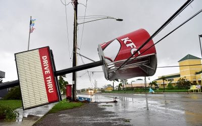 A KFC Sign Damaged By Hurricane Matthew Is Supported By Utility Lines