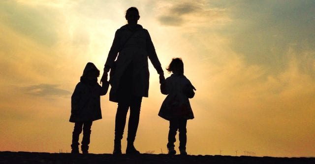 Mother with Daughters Looking at Sunset