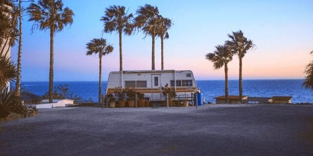 RV On A Beach At Sunrise